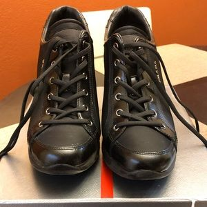 Black Prada wedge tennis shoes.